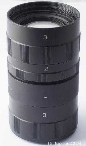 尼克尔(Nikkor)扫描仪100毫米,延伸管贴在枪管上。
