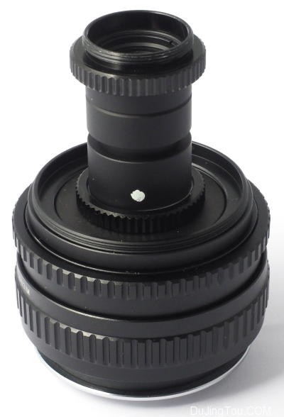 尼克尔(Nikkor)扫描仪40毫米,两端均贴有C延长管,安装在螺旋线上。 扫描仪中面向传感器的一端在底部。 螺旋线扩展到在Micro 4/3上产生1倍放大倍率所需的量。